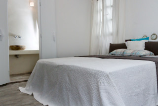 penthouse enosis apartments bed